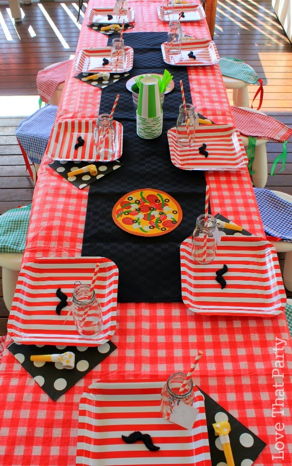 kids party table decoration at pizza party boys party ideas party planning printable diy party decorations moustache glass milk bottles paper plates paper straws red stripe