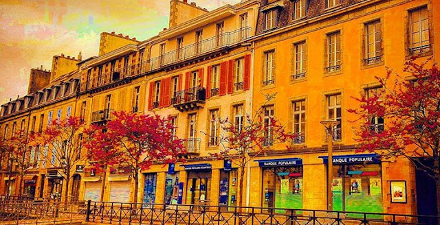 The beautiful flowers tree in front of a colorful building in Quimper