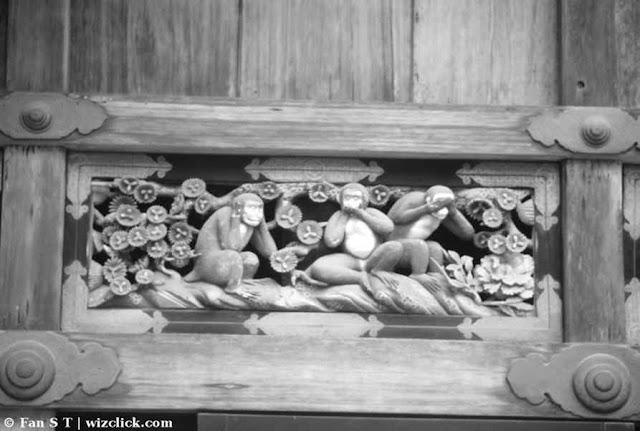 Monochrome image of the three wise monkeys