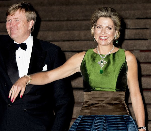 Queen Maxima diamond earrings, aqua-marine satin long dress, Natan shoes