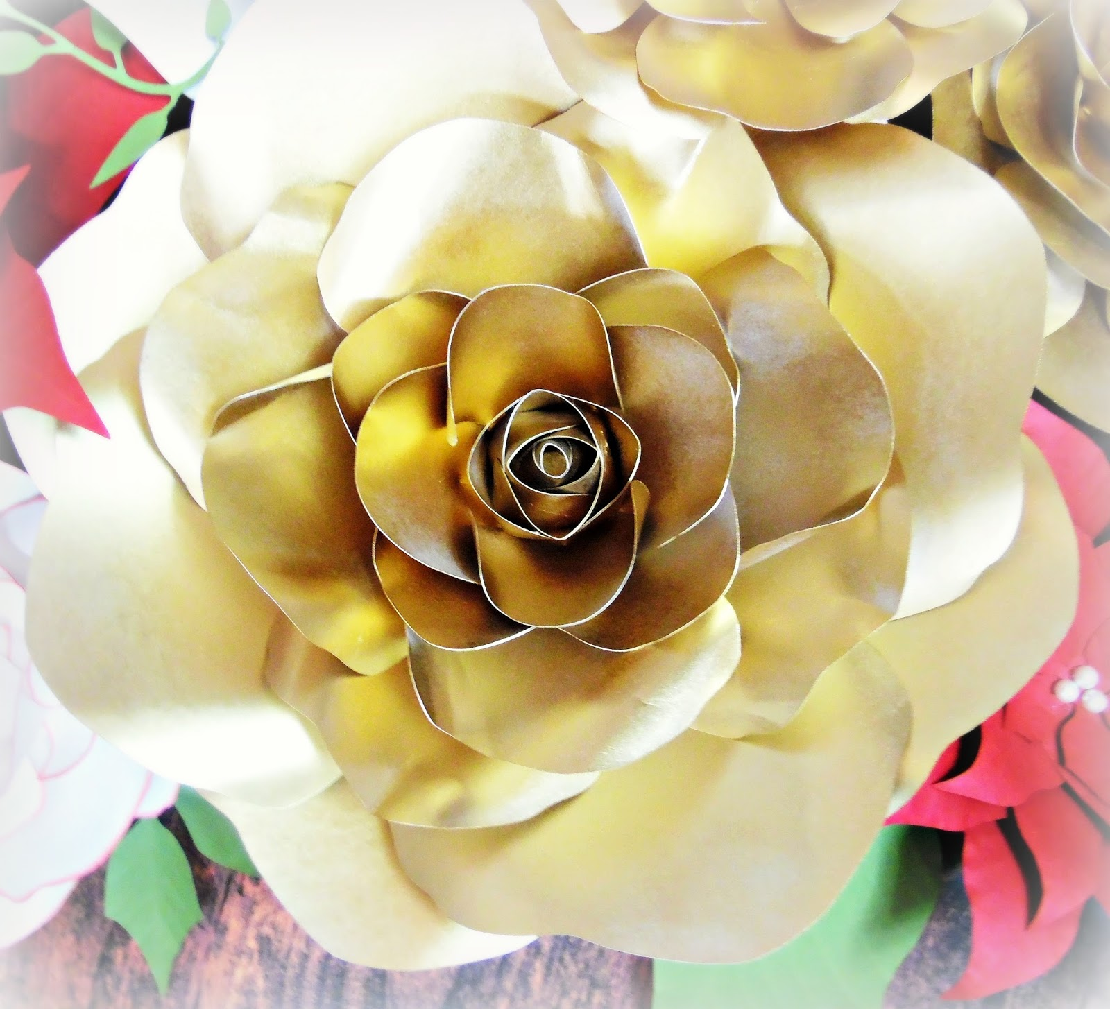 Gold paper flowers golden christmas inspirations catching colorlfies add extra pizzazz to paper flowers or really any item in your christmas closet that needs a fresh look and you just dont have the heart to throw out mightylinksfo