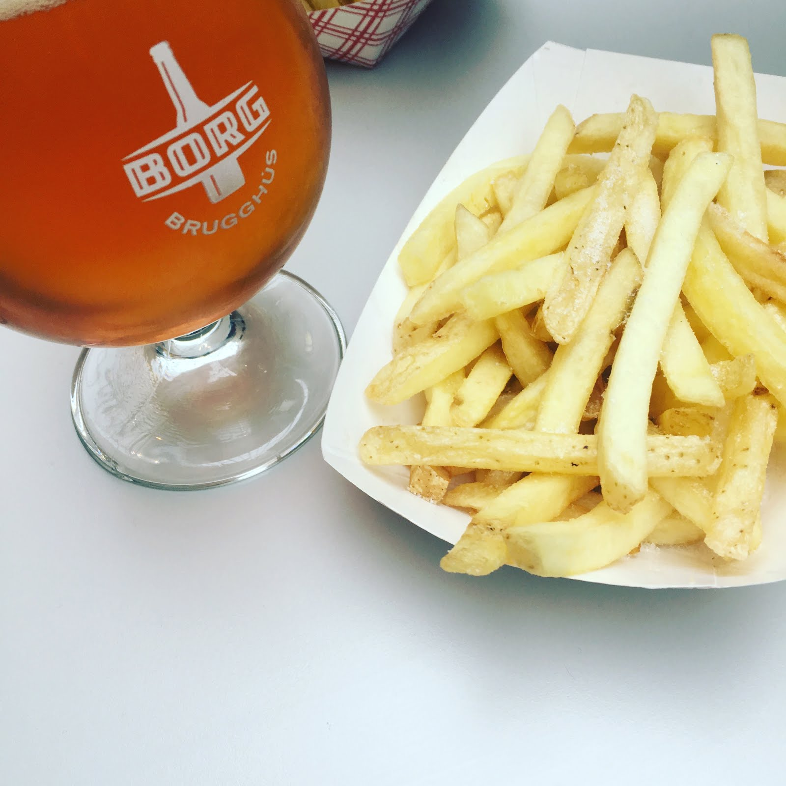 French fries and beer at the airport.