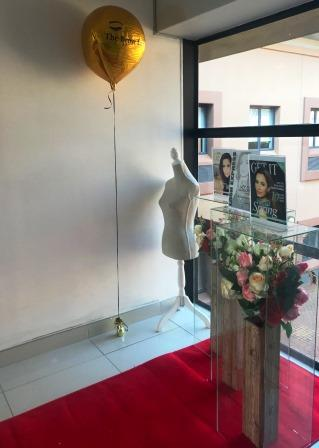 The Brow Bar entrance with balloon and flower arrangement - Clearwater