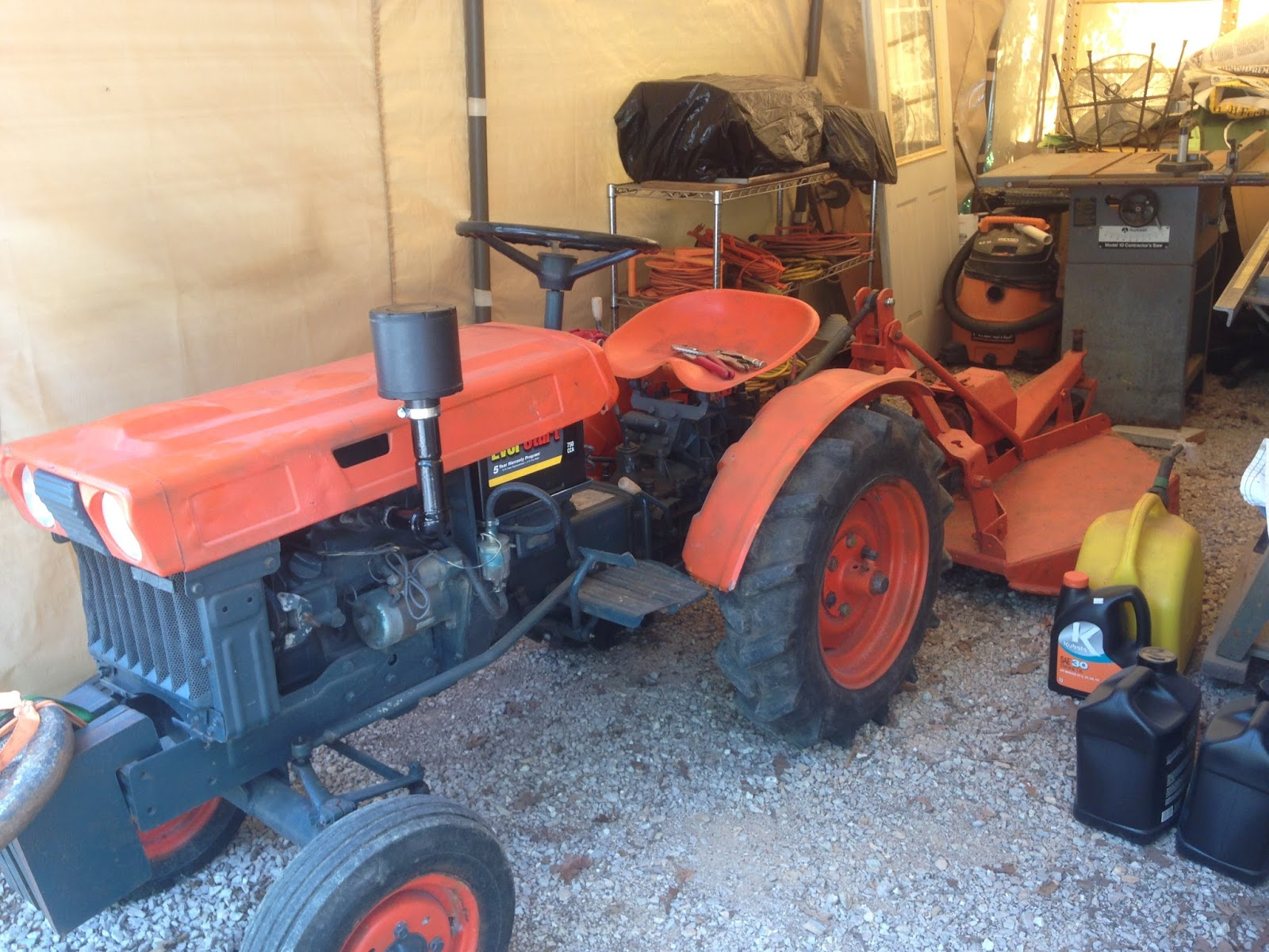 medium resolution of the new old 1970s little orange tractor