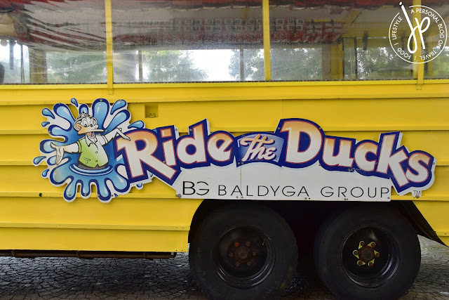 "yellow amphibious vehicle with ""ride the ducks"" text"