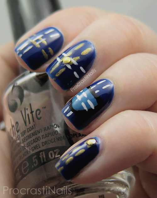 Blue, gold, black and white nail art with a denim look