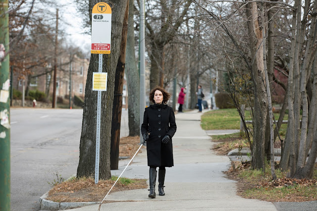 Joann Becker walking near bus stop