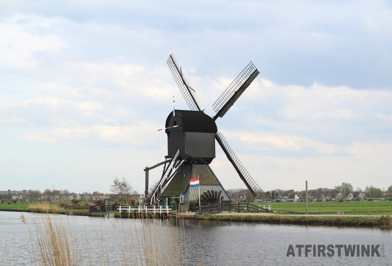 kinderdijk black windmill waterwheel closeup