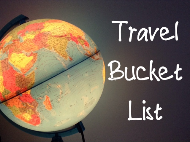 To the left of the image is a globe lamp. The side that is facing us shows Africa, the Indian Ocean, and a part of Asia. On the right of the image it the words 'Travel Bucket List' stacked on top of each other. They are written in a handwritten kind of font. The words are also in white.