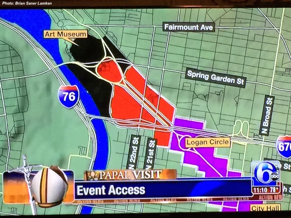 TV screen displaying grid of Philadelphia on local news in which colors and lines identifying event areas during Pope's visit to the city strongly resemble the red, horned figure of Satan complete with goatee