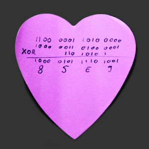 [Image: A pink, heart-shaped Post-It note with a hand-written columnar XOR calculation in binary. One of the operands is shifted left from the alignment. The result is 85E9.]