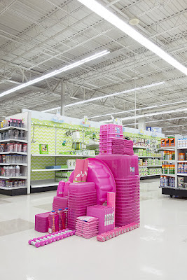 Things organised neatly pink plastic items in supermarket