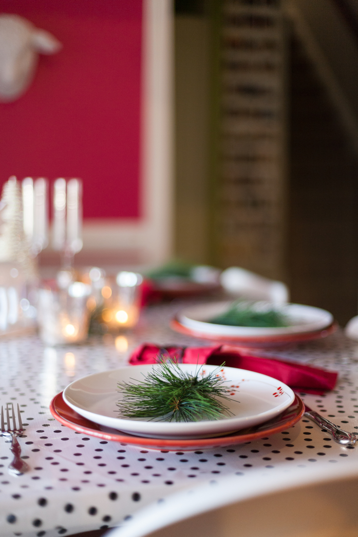 Black and white tablecloth is a great backdrop for this holiday table.
