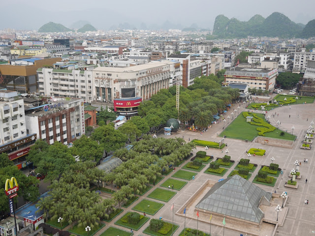 view of a Chinese city with a McDonald's