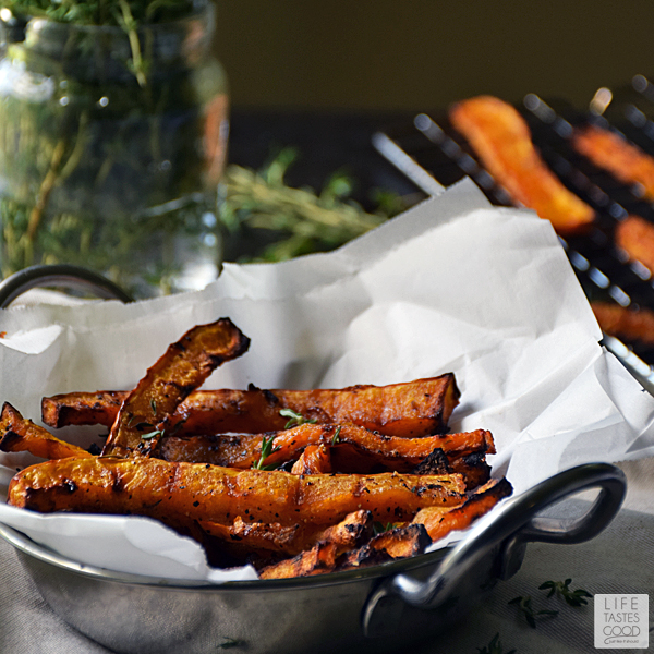 Honey Baked Butternut Squash Fries | by Life Tastes Good  are a sweet and savory side dish perfect for fall! The subtle honey flavor combined with the sweet, nuttiness of butternut squash and a touch of thyme for that savory flare, will have you begging for more! #LTGrecipes