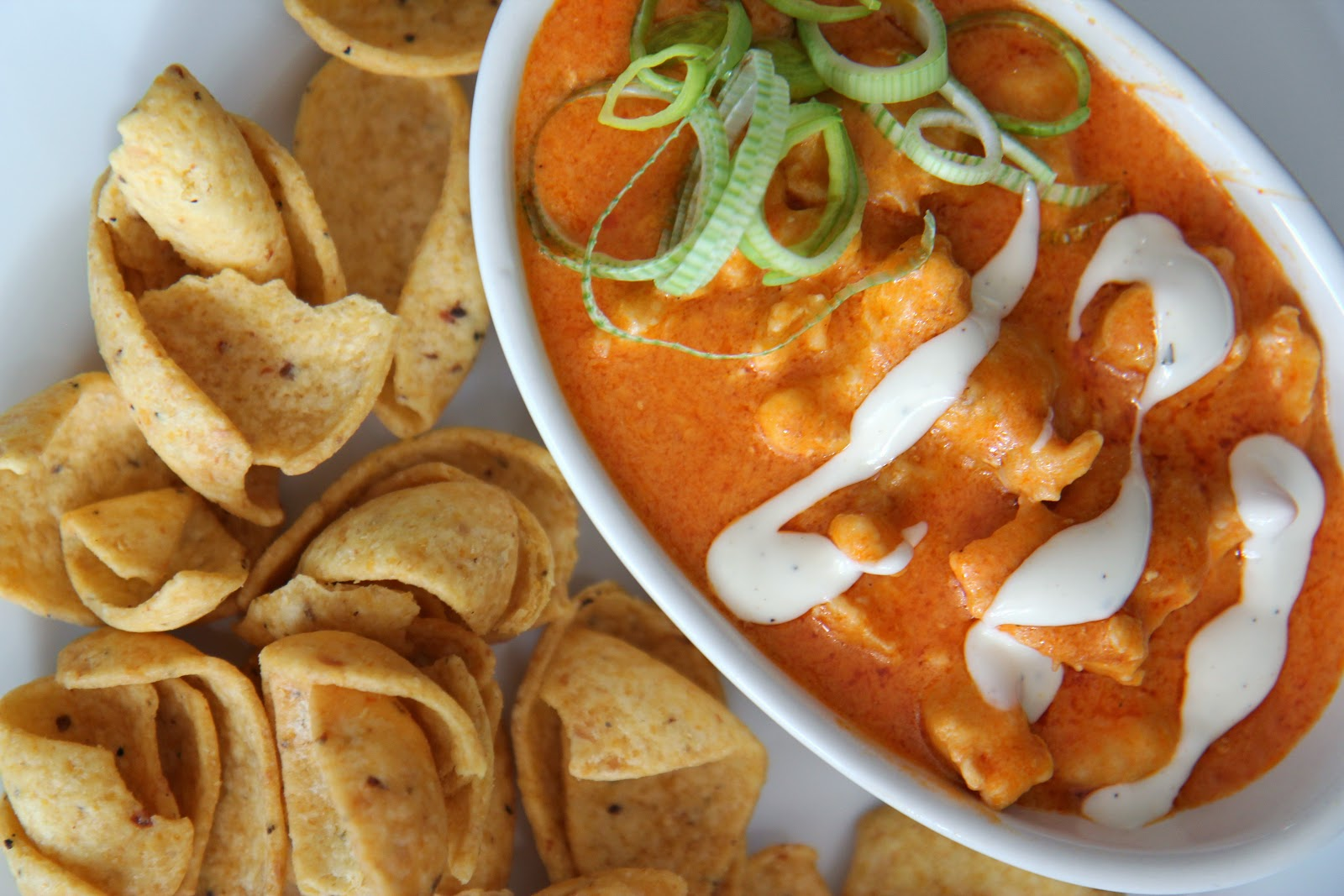 Celebrate the big game with this delicious Frito-garnished dip, made to taste like your favorite Buffalo-style chicken!