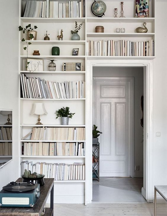 Breathtaking beautiful Swedish style interior design with built-in bookshelves - found on Hello Lovely Studio