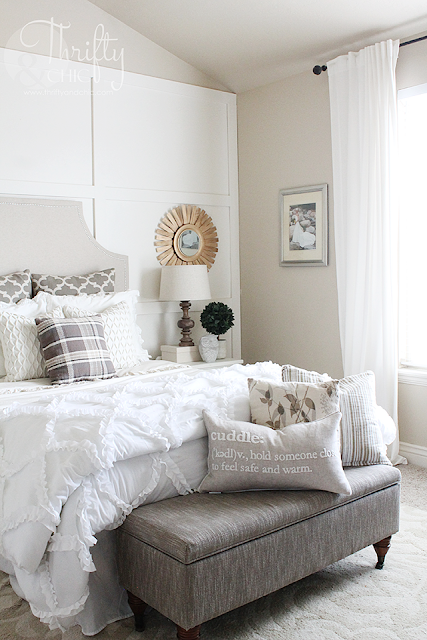 Neutral Fall decorating ideas and decor. Neutral and white bedroom decor. Great way to break up wall in master bedroom with vaulted ceiling