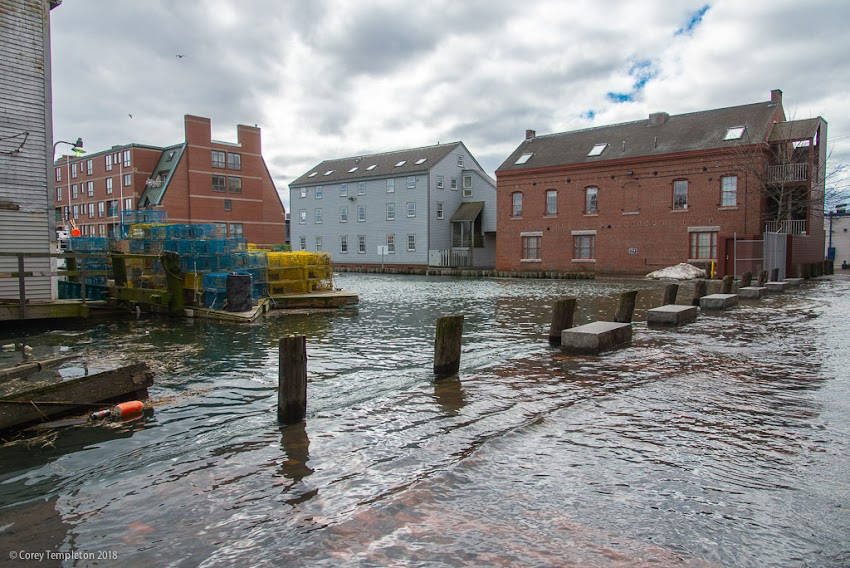 Portland, Maine USA March 2018 photo by Corey Templeton of flooding at high tide at Custom House Wharf in the Old Port.