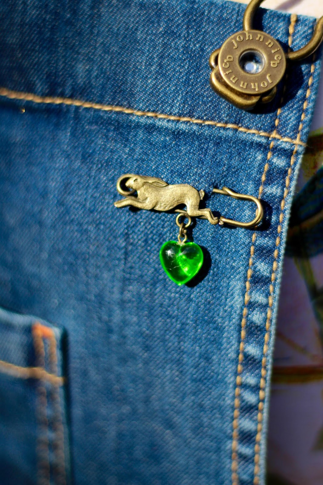 Fake Fabulous | Running Hare pin with green gem.