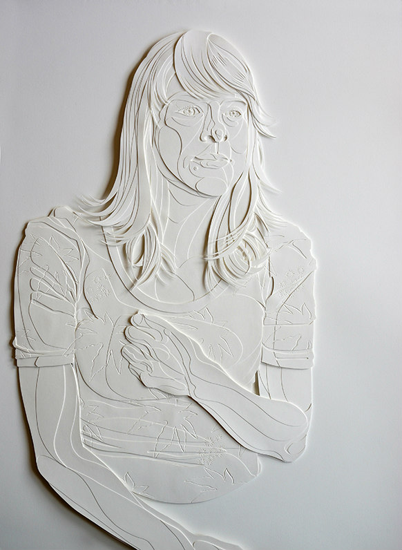 Monochromatic cut paper portrait of young woman