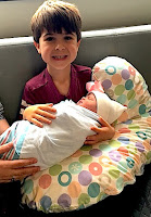 Alex Romero with newborn sister