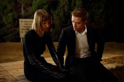 Mia Wasikowska as Agatha Weiss, Robert Pattinson as Jerome Fontana, in Maps to the Stars, Directed by David Cronenberg