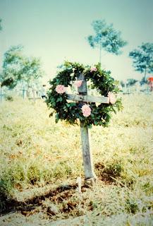 Cross with wreath in Sociedad, El Salvador, decorated for All Saints' Day or Dia de los Santos