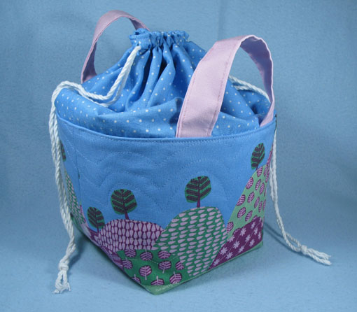 Fabric Basket with a Drawstring Top TUTORIAL... Make a fabric basket that is enclosed with a drawstring top. Step by step instructions showing you how. ~ Threading My Way