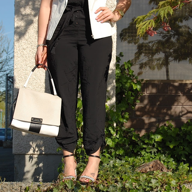 Stylestalker white leather vest, black jumpsuit and Zara sandals