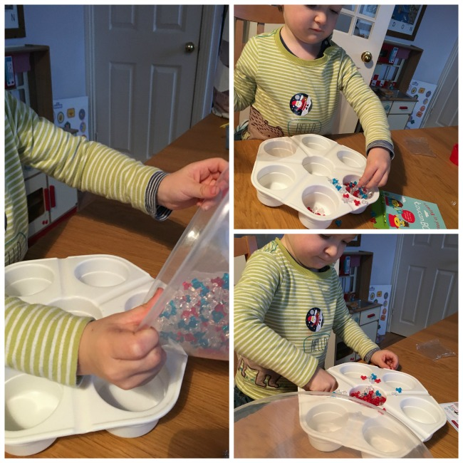 toucanBox-Subscription-Box-review-toddler-playing-with-the-beads-pouring-from-a-bowl-into-paint-pots
