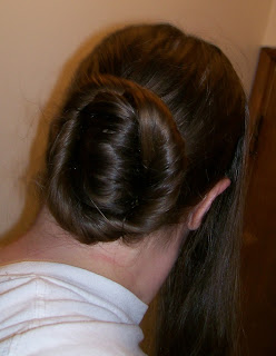 French twist, with extra hair length wrapped around.