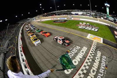 Christopher Bell, driver of the #20 Rheem Toyota, leads the field to green