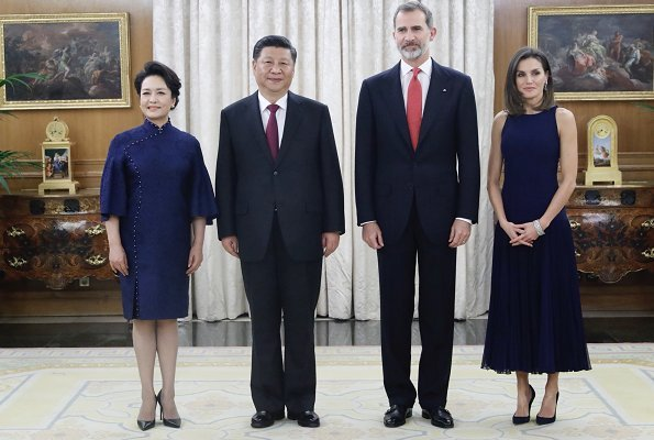 Queen Letizia wore Felipe Varela skirt and top and Nina Ricci pumps. Peng Liyuan. Queen Victoria Eugenia's Cartier diamond earrings