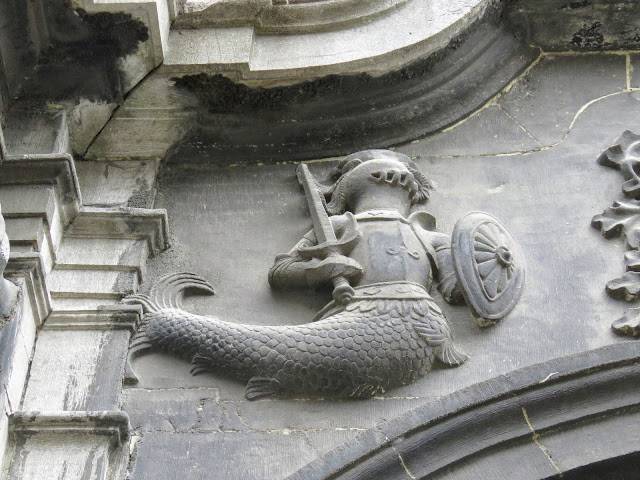 What to do in Mons Belgium in One Day: Armoured mermaid sculpture at Sainte-Elizabeth church