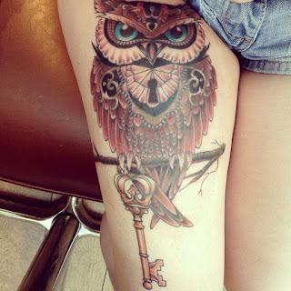 El buho en el tatuaje