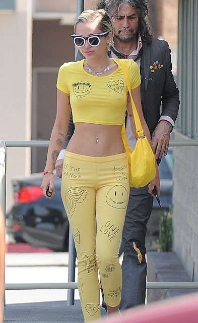 Miley Cyrus braless tiny yellow crop top and matching leggings