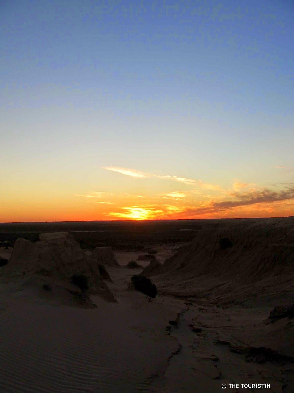 Sunset over a desert landscape.