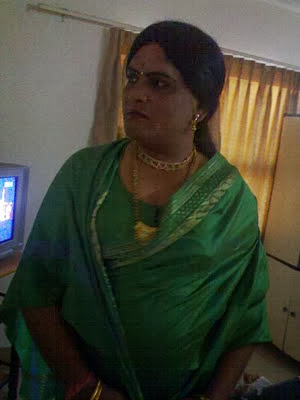 male dulhan wearing green saree