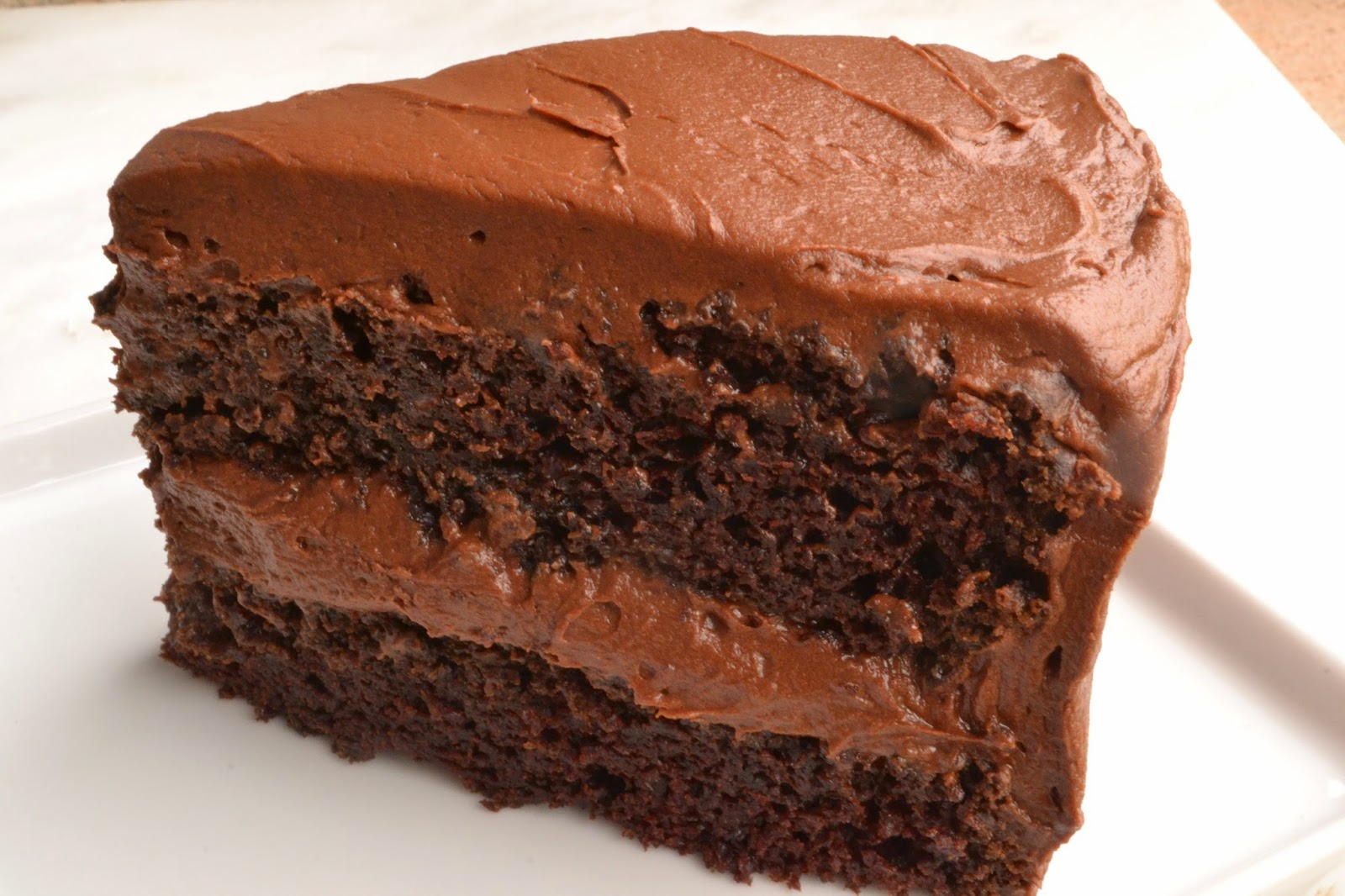 This recipe makes decadent chocolate cake and delicious chocolate cupcakes Dont skip the silky frosting its the best part!