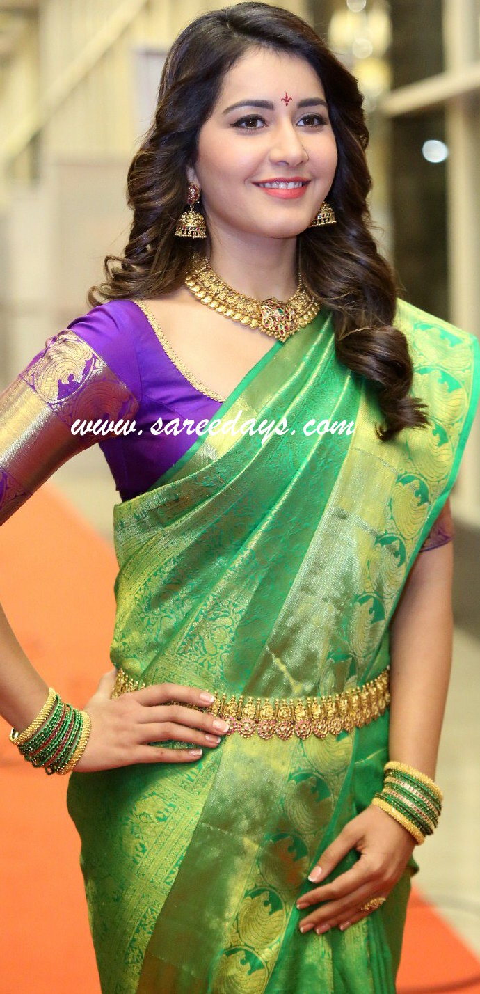 Latest saree designs rashi khanna in green traditional saree checkout rashi khanna in green traditional saree with zari border and paired with contrast purple half sleeves blouse altavistaventures Images