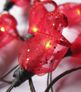 http://manualidadesnavidad.org/flores-tela-para-luces-navidad/