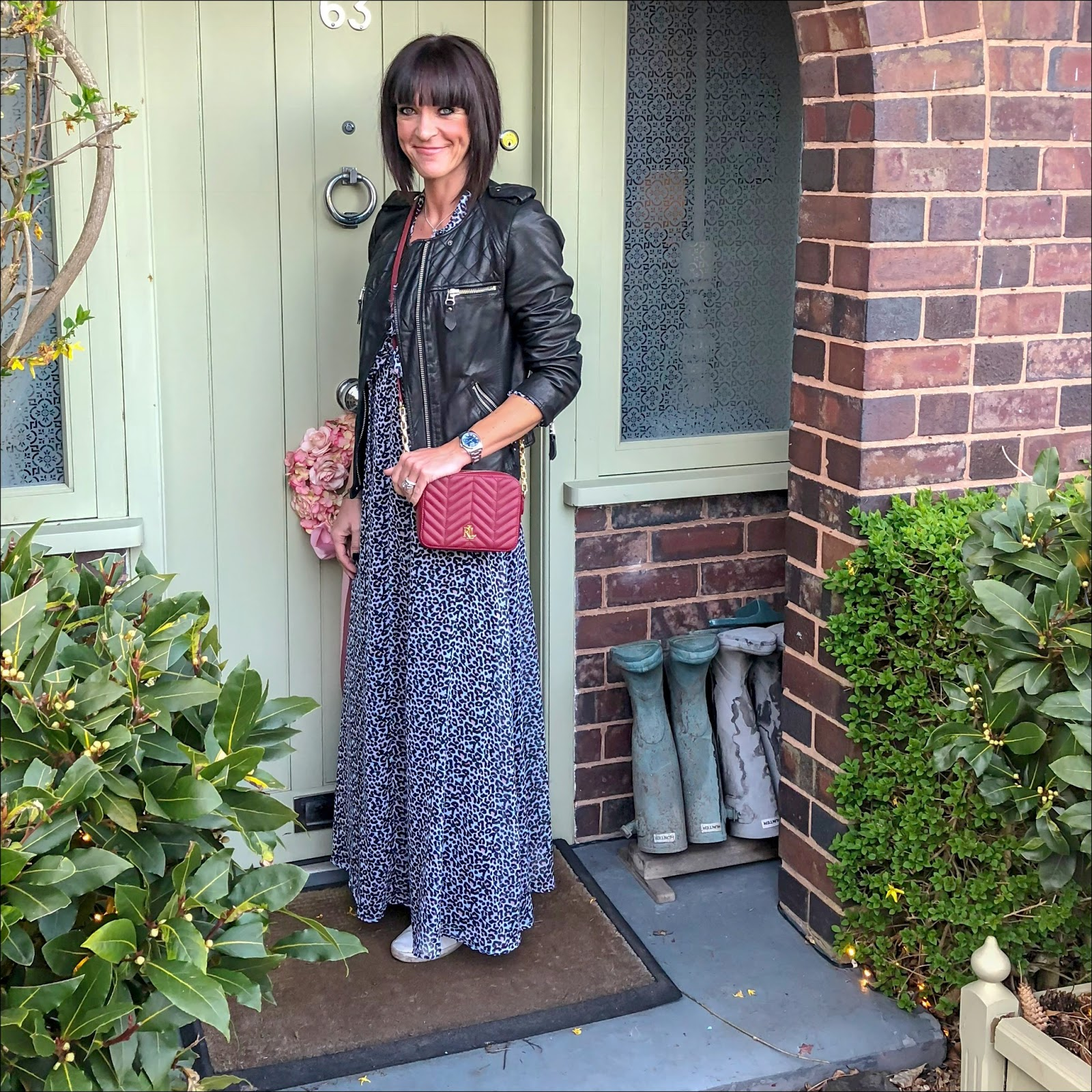 my midlife fashion, isabel marant etoile leather jacket, lauren ralph lauren payton small cross body bag, lily and lionel leopard print maxi dress, golden goose superstar low top leather trainers