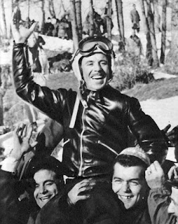 Lamberto dalla Costa is carried by members of  the Italian team after his victory in 1956