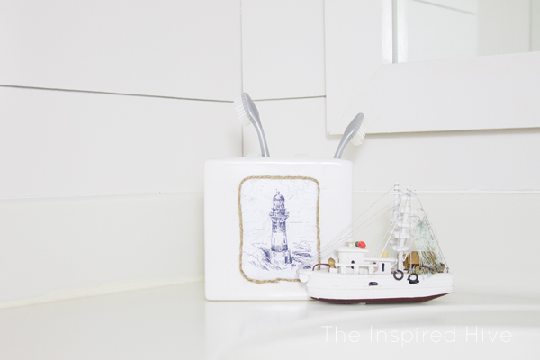 Can't find the perfect bath accessories? DIY them! Check out this nautical toothbrush holder.