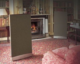 Image of Quad ESL 989 electrostatic speakers inside a living room with many pink accents