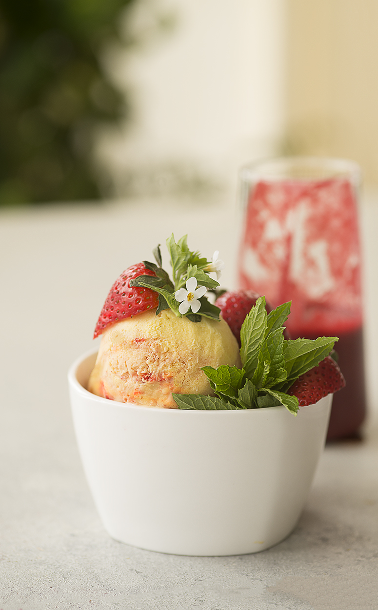Mango ice cream with strawberry swirl