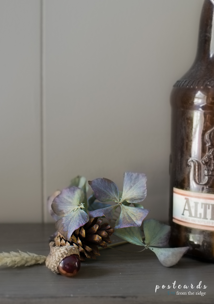 glass acorn and dried hydrangea petals