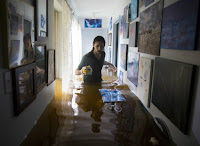 Matthew Koser looks for heirlooms in his grandfather's flooded house after Hurricane Harvey deluged the Houston area this week. (Credit: Erich Schlegel/Getty) Click to Enlarge.