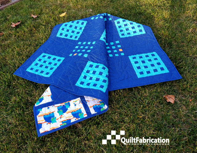 Hippo Blue quilt on the grass